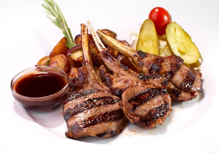 grilled rack of veal with potato Imagens
