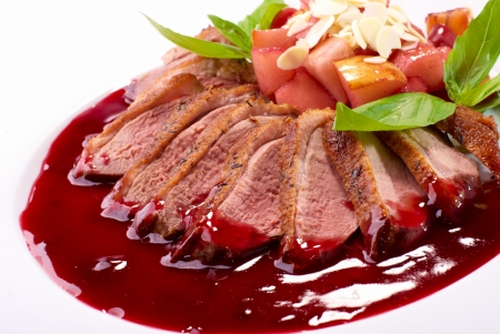red breast: Roasted duck fillet with berry sauce close-up