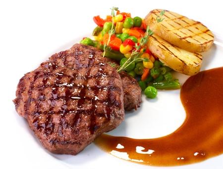 Rib-eye steak with vegetables on white Stock Photo - 17801825