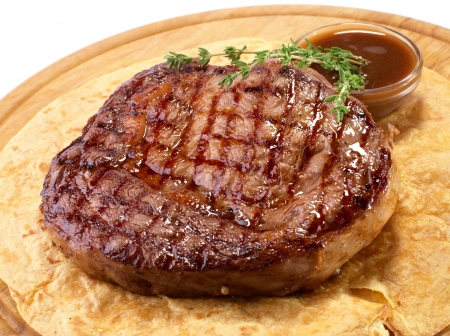 Rib-eye steak resting on the wooden plate Stock Photo - 17801837
