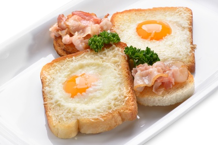 traditional breakfast of scrambled eggs and toast Stock Photo