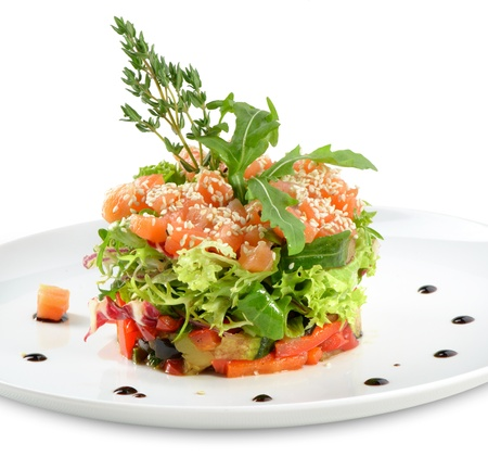 fresh salad whith salmon and vegetables on white