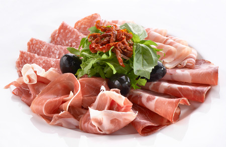 antipasto platter: meat snack with prosciutto, salami and bacon Stock Photo