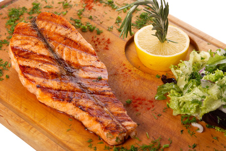 grilled salmon steak on wooden plate  Stock Photo