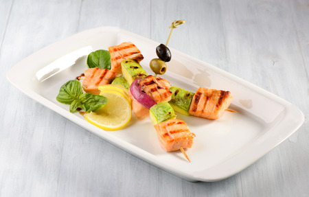 Grilled salmon with zucchini on a stick Stock Photo
