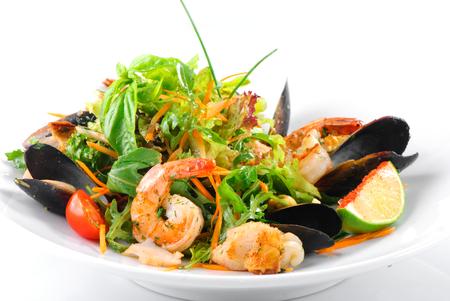 seafood salad: Fresh salad with seafood on white plate
