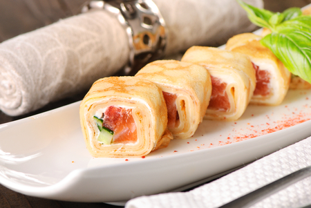 Pancake roll with salmon. Close-up shot Imagens