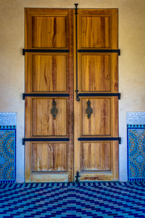 Wooden door with metal fittings