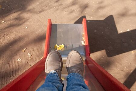 Back to the childhood, memories, feet women on the playground