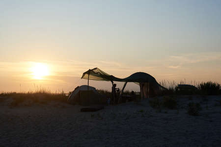 Couple, family vacation in a tent at sunset on sea Stock fotó