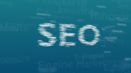 Light blue background with different words, which deal with Search Engine Optimization. The bold word is situated on the centre of composition. Close up. Copy space. 3D.