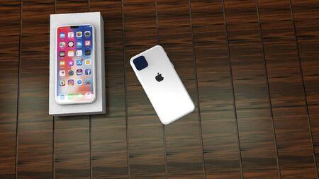 Chernivtsi, Ukraine - July 11, 2019: Unboxing new Apple iPhone11, on wood background.