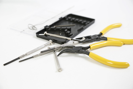 flatnose: Pliers and screwdriver on white background Stock Photo
