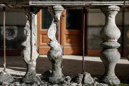 garden statuary: Old stone destroyed the railing on the background of the doors Stock Photo