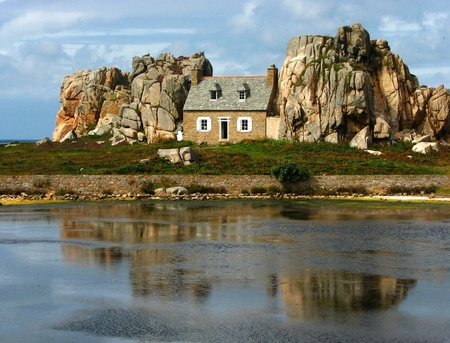 known house between rocks in brittany