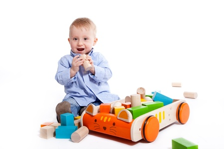 One year old boy playing with wooden blocks photo