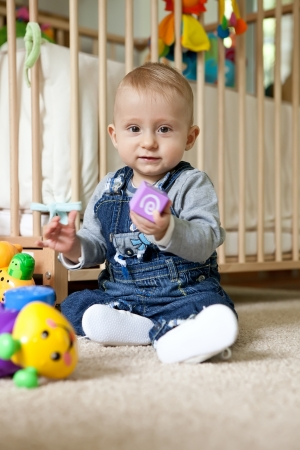 Baby boy playing with toys photo