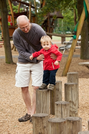 Father and son playing on playground photo