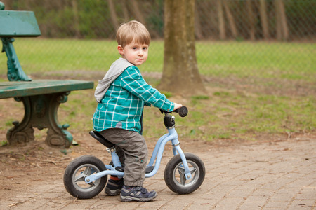 Two years old boy on a bike  photo