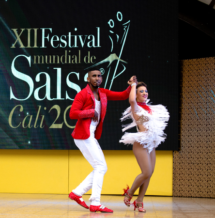 Salsa dancer in International Festival of Salsa in Cali, Colombia (red couple)
