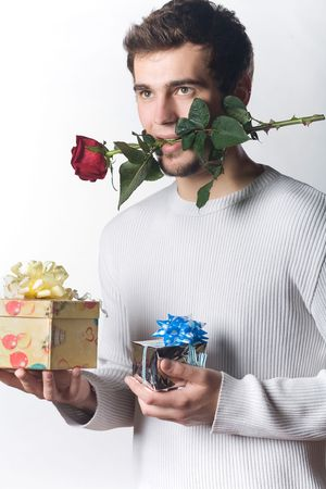 Young man with gifts and rose Stock Photo - 774186