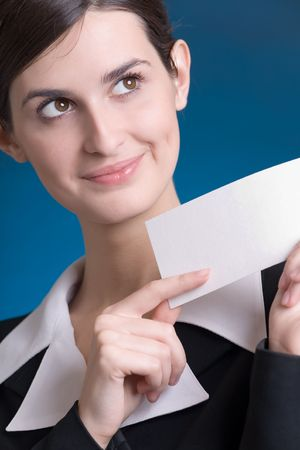 affability: Young secretary or business woman with blank notecard Stock Photo