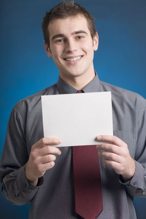 Young business man or student with blank note card, smiling Stock Photo - 774188