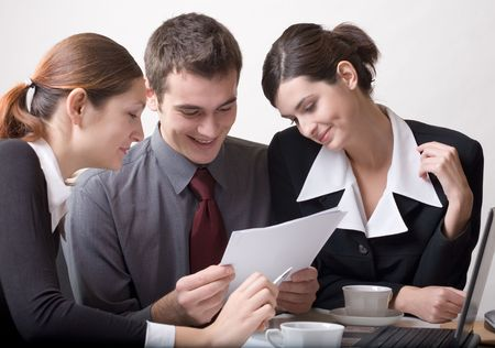 Businessman and two businesswomen working Stock Photo - 774189