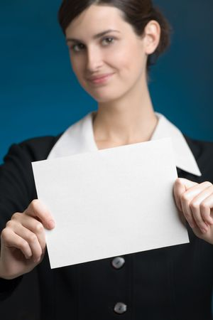 affability: Young secretary or businesswoman with blank note card, focus on the card Stock Photo