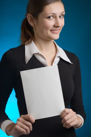 affability: Young secretary or businesswoman with blank note card, smiling