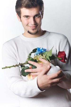 Young man with gifts and rose Stock Photo - 816606