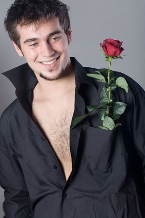 Young smiling man with rose Stock Photo - 816610