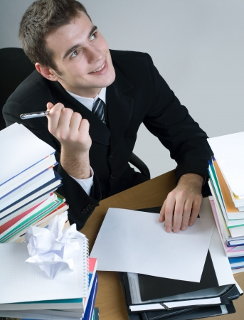 Young student or business man writing something on the blank paper, smiling Stock Photo - 816961