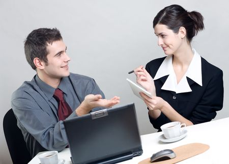 Bussinessman and businesswoman working at office photo
