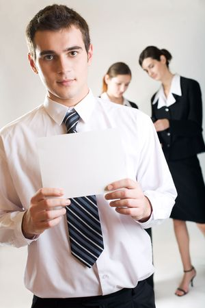 Young businessman with blank note-card and two businesswomen Stock Photo - 835051