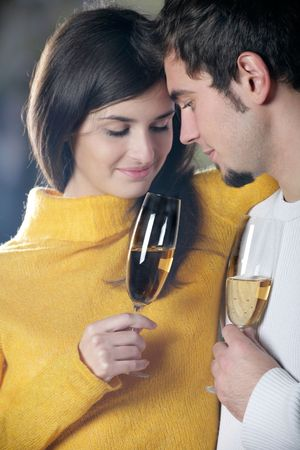Young couple with champagne glasses, outdoors photo