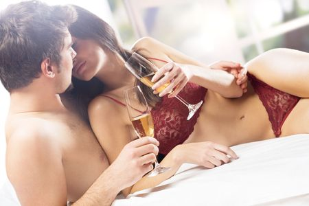 Couple kissing and drinking on the bed in bedroom Stock Photo - 844510