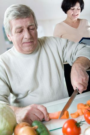 Elderly happy couple cooking at kitchen Stock Photo - 846004