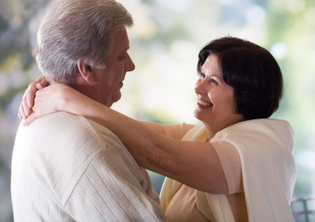 Happy old couple embracing or dancing, outside photo