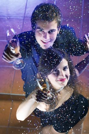 Young couple at celebration with glasses and confetti  Stock Photo - 868279