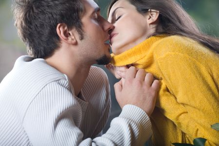 young couple kissing: Young couple kissing, outdoors Stock Photo