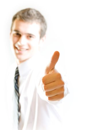 affirmative: Young smiling happy student or business man with affirmative gesture, isolated on white background. Focus directly on the hand. Stock Photo