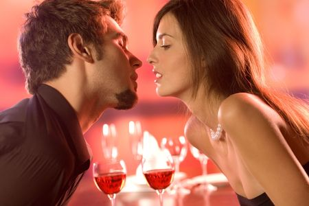 Young couple in restaurant, celebrating or on romantic date Stock Photo - 872921