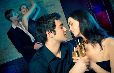 birthday suit: Two young attractive happy couples at celebration or night party  Stock Photo