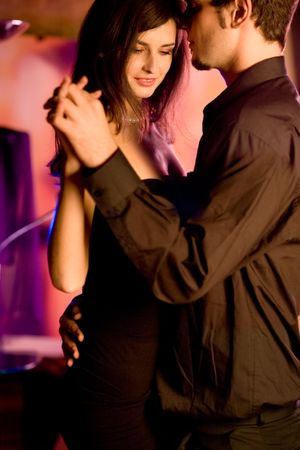 suprise: Young couple dancing at the restaurant or cafe Stock Photo