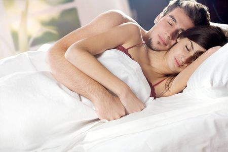 Young couple sleeping and hugging on the bed in bedroom Stock Photo - 885169