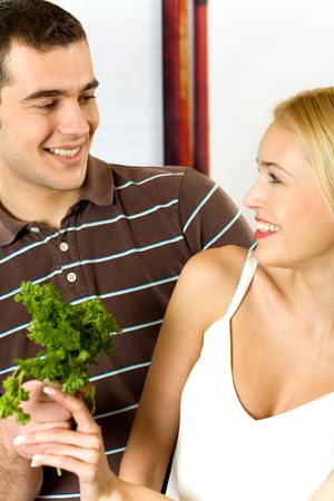 Young attractive happy smiling couple at the kitchen. Focus at man. Stock Photo - 911677