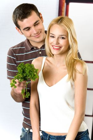 Young attractive happy smiling couple cooking at the kitchen Stock Photo - 911678