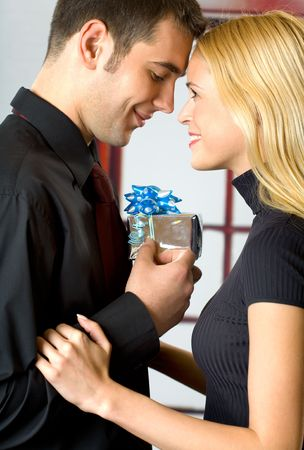Young happy attractive smiling couple with gift box Stock Photo - 925396