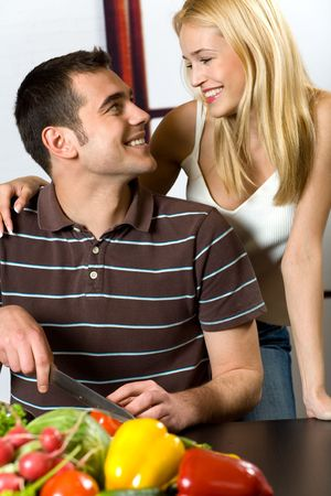 Young attractive happy smiling couple cooking at the kitchen Stock Photo - 925412